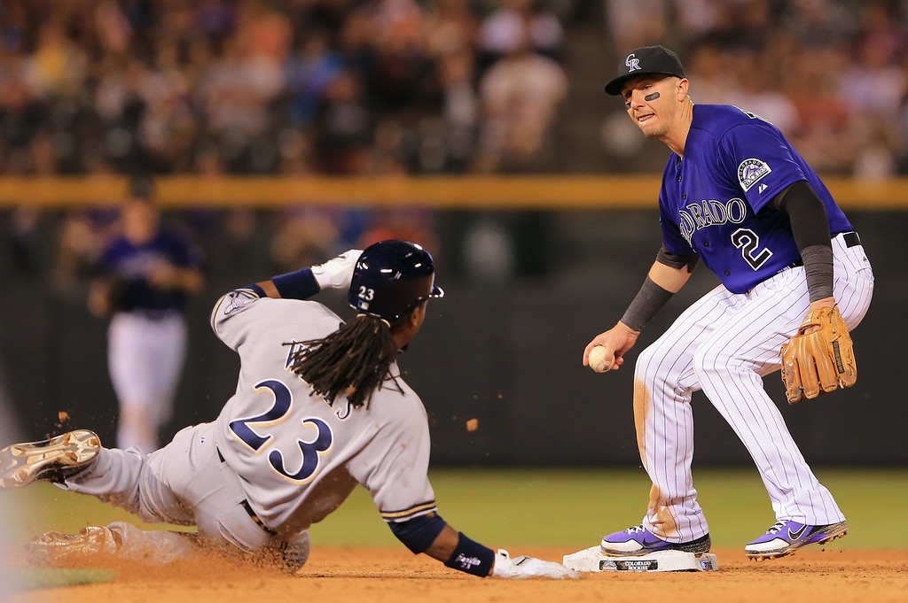. DENVER, CO - JULY 26:  Shortstop Troy Tulowitzki #2 of the Colorado Rockies gets a force out on Rickie Weeks #23 of the Milwaukee Brewers in the eighth inning at Coors Field on July 26, 2013 in Denver, Colorado.  (Photo by Doug Pensinger/Getty Images)
