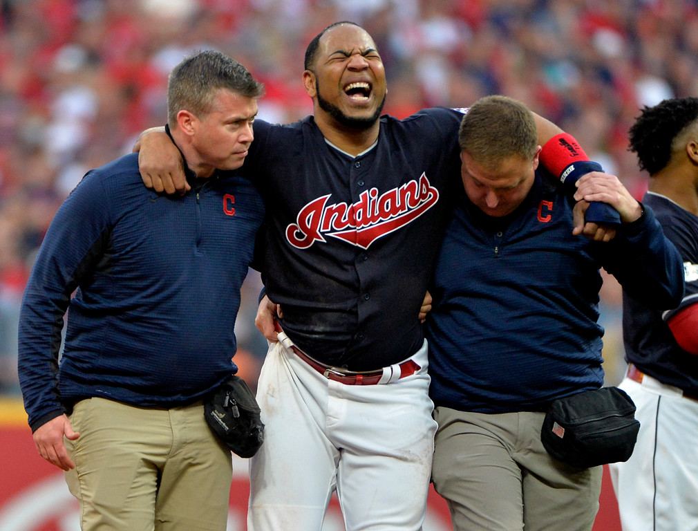 . Cleveland Indians\' Edwin Encarnacion is carried off the field after rolling his ankle at second base in the second inning of Game 2 of baseball\'s American League Division Series against the New York Yankees, Friday, Oct. 6, 2017, in Cleveland. (AP Photo/Phil Long)