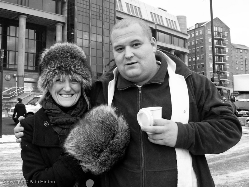 Mark 67/100  Mark, a meat vendor we met at the Quayside Market, began chatting up my friend Shirley, initially for her warm fur hat. In the end, a marriage proposal was offered. What a character!