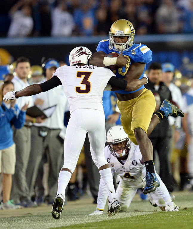. UCLA�s Myles Jack #30 looks to avoid the tackle of Arizona State�s Richard Smith #3 during their game at the Rose Bowl Saturday November 23, 2013. (Photos by Hans Gutknecht/Los Angeles Daily News)