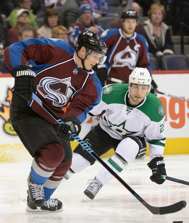 . Colorado Avalanche defenseman Nick Holden (2) takes control of the puck while Dallas Stars center Colton Sceviour (22) looks for the steal during the second period Saturday, February 14, 2015 at the Pepsi Center in Denver, Colorado. (Photo By Brent Lewis/The Denver Post)