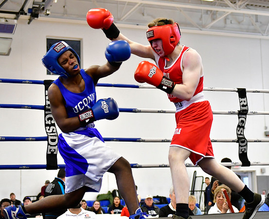 3/16/2019 Mike Orazzi | Staff UMass Anton Pritchard (Red) and UConns Matt Haynes(blue) in a 139 match during the National Collegiate Boxing Association National Qualifier held at the Bristol Boys & Girls Club in Bristol, Conn. on Saturday.
