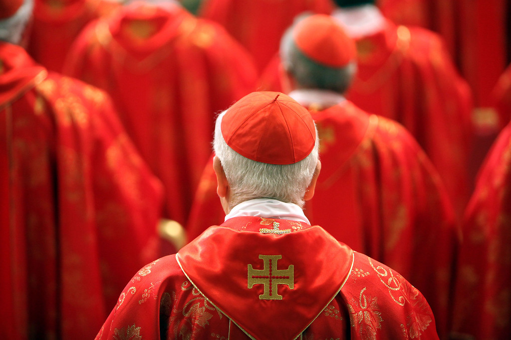 . Cardinals attend the Pro Eligendo Romano Pontifice Mass at St Peter\'s Basilica, before they enter the conclave to decide who the next pope will be, on March 12, 2013 in Vatican City, Vatican.  (Photo by Franco Origlia/Getty Images)