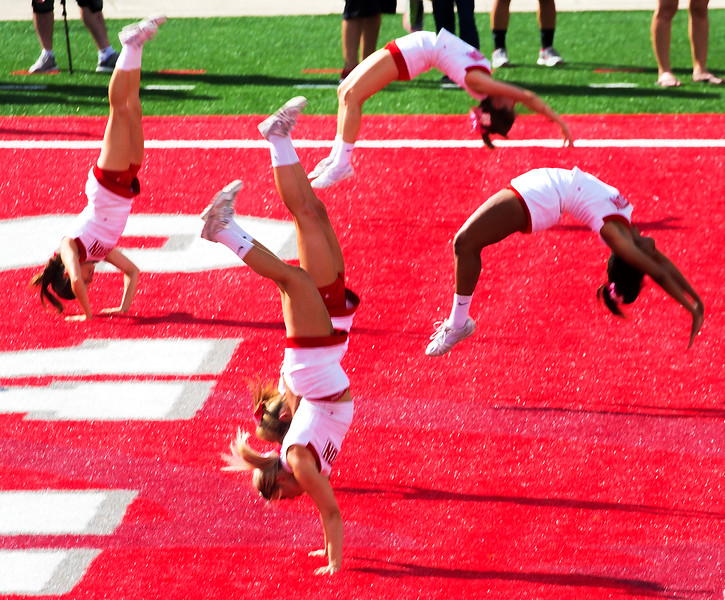 Five cheerleaders in various states of upside-down
