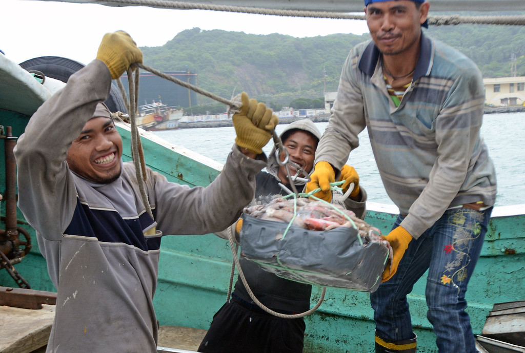 . Foreign fish workers load the catches at the Patoutze fish harbor, in Keelung, northern Taiwan on October 5, 2013. Taiwan on October 5 issued a warning over Typhoon Fitow as it approached the island\'s north with threats of torrential rains and powerful winds over the weekend.   SAM YEH/AFP/Getty Images