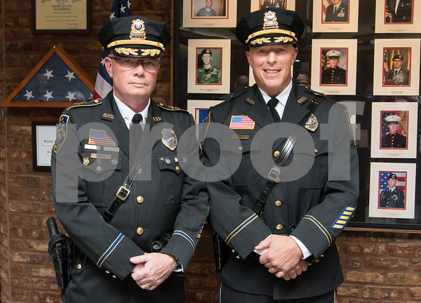 10/18/17 Wesley Bunnell | Staff Berlin held an official ceremony on Wednesday night for the incoming Chief of Police John Klett, L, and Deputy Chief Chris Ciuci.