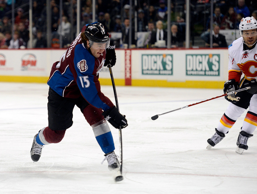 . DENVER, CO. - FEBRUARY 28: P.A. Parenteau (15) of the Colorado Avalanche takes a shot on goal during the first period against the Calgary Flames February 28, 2013 at Pepsi Center.(Photo By John Leyba/The Denver Post)