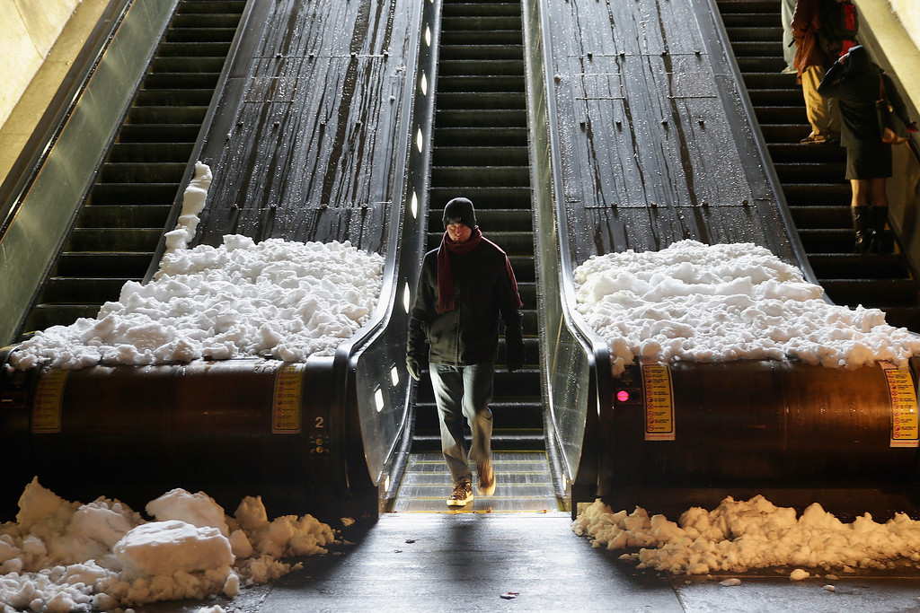 . Snow slides down and collects at the base of the escalators at the Dupont Circle Metrorail Station February 13, 2014 in Washington, DC. Up to 12 inches of snow fell over the Washington area causing WMATA to cancel bus service but rail service continued to operate.  (Photo by Chip Somodevilla/Getty Images)
