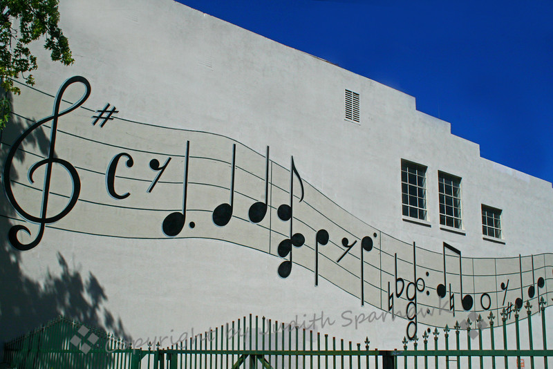 Music On The Wall ~ I happened on this mural on the back of a building in downtown San Bernardino, California.  I liked the lilting feel of the musical score.