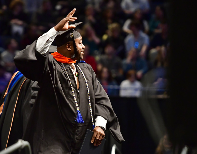 5/18/2019 Mike Orazzi | Staff CCSU graduate NiiObli Lomotey on commencement day at the XL Center in Hartford on Saturday.
