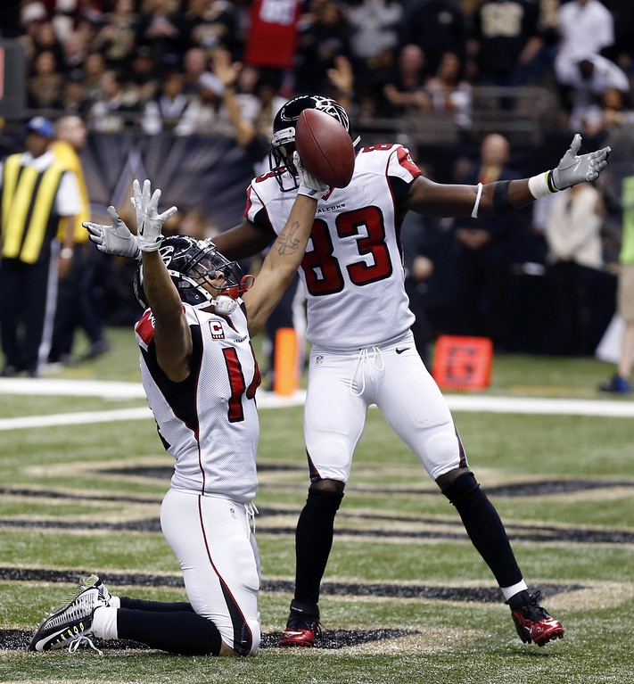 . Atlanta Falcons wide receiver Eric Weems (14) celebrates his touchdown with wide receiver Harry Douglas (83) in the first half of an NFL football game against the New Orleans Saints in New Orleans, Sunday, Dec. 21, 2014. (AP Photo/Rogelio Solis)