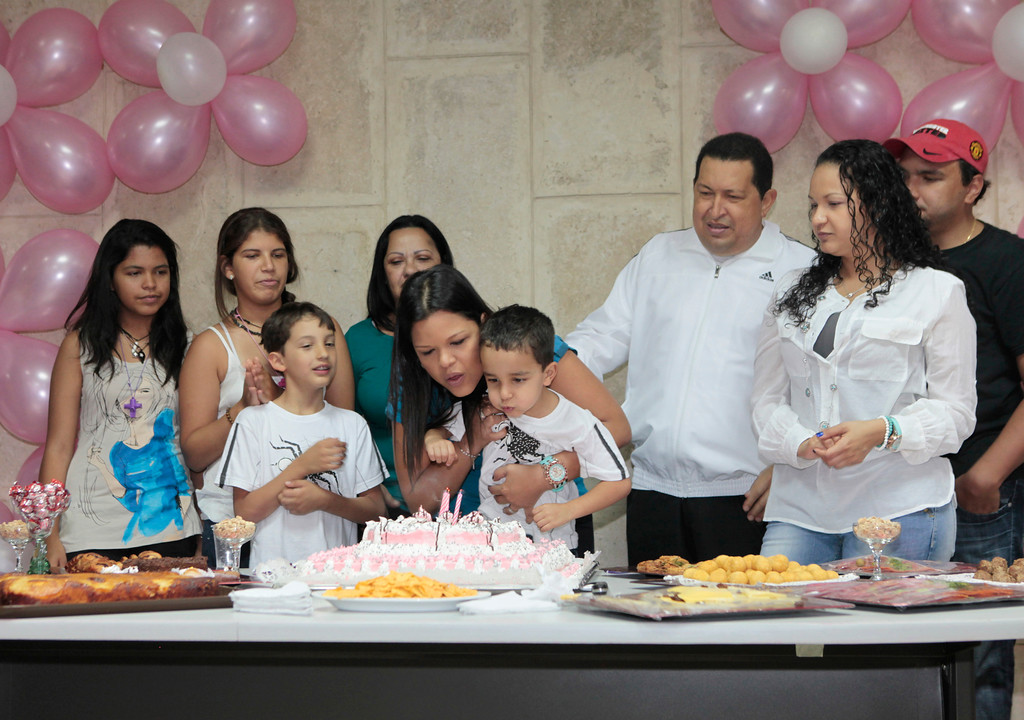 . Venezuelan president Hugo Chavez (3rd R) celebrates the birthday of his daughter Maria Gabriela (C) with his family in La Habana March 13, 2012. Chavez said he will return home from Cuba where he is recovering from cancer surgery next Sunday, to head up a re-election campaign. REUTERS/Handout/Miraflores Palace