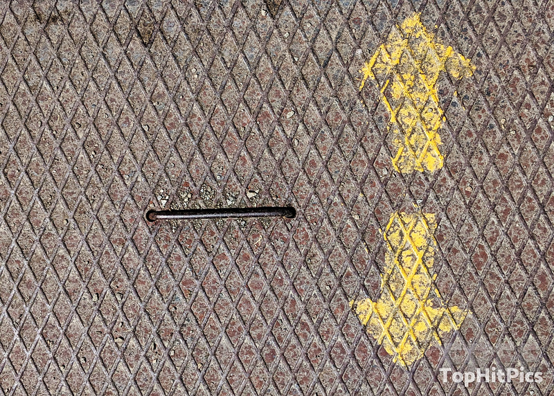 Arrows On A Metal Grid
