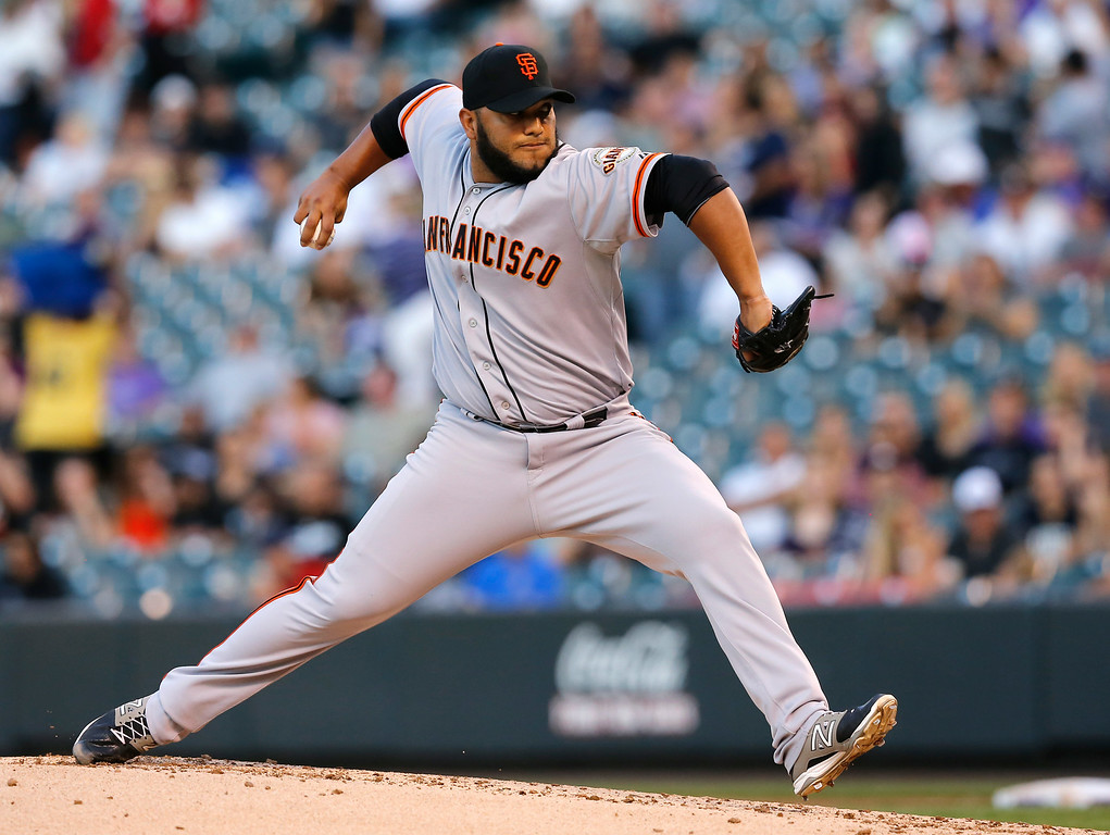 . San Francisco Giants starting pitcher Yusmeiro Petit throws to the plate against the against the Colorado Rockies during the first inning of a baseball game Tuesday, Sept. 2, 2014, in Denver. (AP Photo/Jack Dempsey)