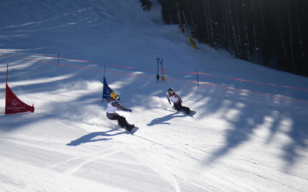 . Winter X Games athletes Hannah Teter, left, and Jamie Anderson race  each other during an event with Special Olympic athletes at Aspen, January, 26 2014. The athlete spent the afternoon racing and having fun.  (Photo by RJ Sangosti/The Denver Post)