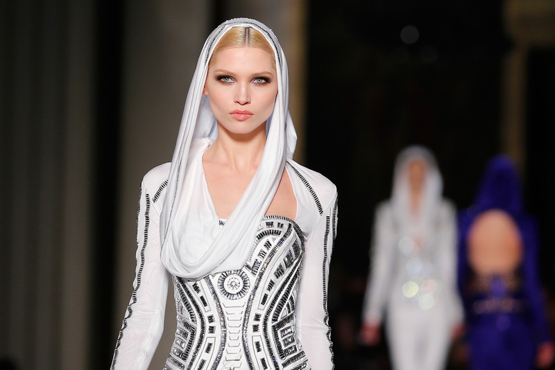 . A model presents a creation by Italian fashion designer Donatella Versace as part of the Atelier Versace Spring-Summer 2014 Haute Couture fashion collection, presented Sunday, Jan. 19, 2014 in Paris. (AP Photo/Jacques Brinon)