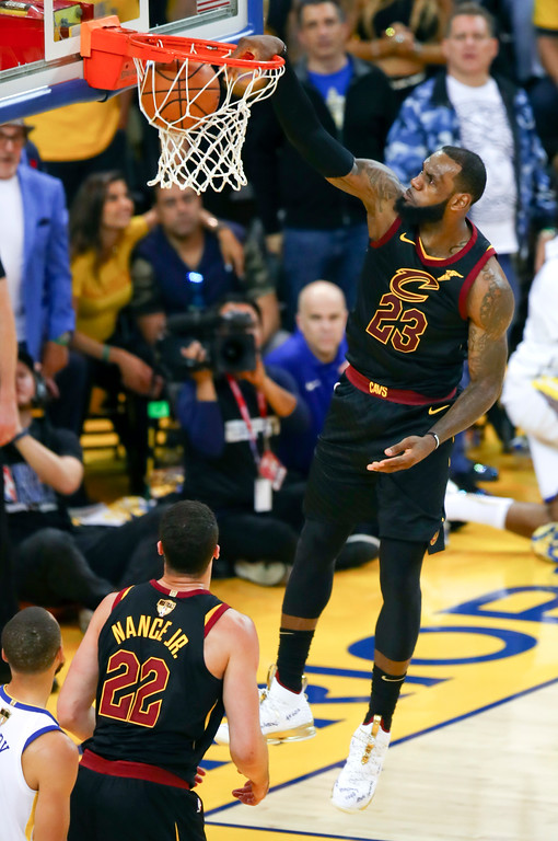 . Cleveland Cavaliers forward LeBron James (23) dunks against the Golden State Warriors during the second half of Game 1 of basketball\'s NBA Finals in Oakland, Calif., Thursday, May 31, 2018. (AP Photo/Ben Margot)