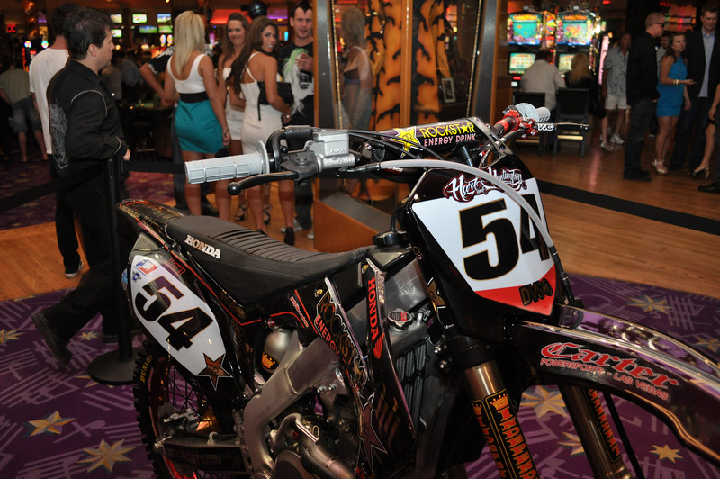 """DOWNLOAD PHOTOS FREE * Courtesy of """"IS Vodka"""" *  www.ISVodka.comMotocross freestyle racer and Gravity Games Champion, inventor of the """"Hart Breaker"""" and """"Superman Seat Grab"""" Carey Hart has his own rock and roll club """"Wasted Space"""" inside of Hard Rock Casino. Carey Hart also has a new tatoo palor Hart and Huntington inside Hard Rock Casino. Check out the big bore Carey Hart racing Honda motocross bikes in Hard Rock Lobby."""