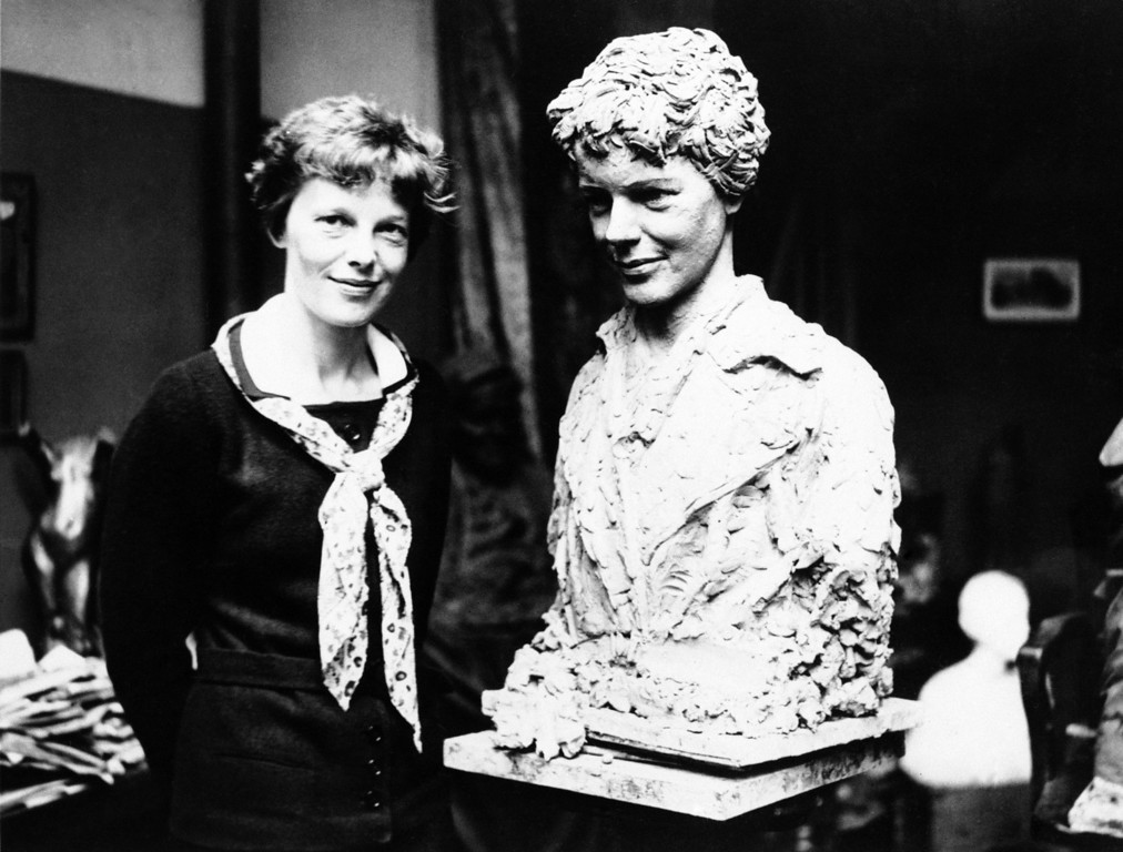 . Mrs. Amelia Earhart Putnam pictured beside a likeness of herself executed by George Conlon, an American sculptor now living in Paris in an undated photo. The bust which is remarkable facsimile of the transatlantic flier was modeled almost entirely with the aid of photographs because of the inability of the flier to devote most of her time while in Paris to the sittings. (AP Photo)
