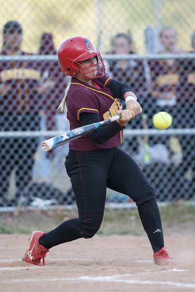 Sheehan's Becca Souza (13) sends one deep for a triple Wednesday at Pragemann Park in Wallingford  May. 13, 2015 | Justin Weekes / For the Record-Journal