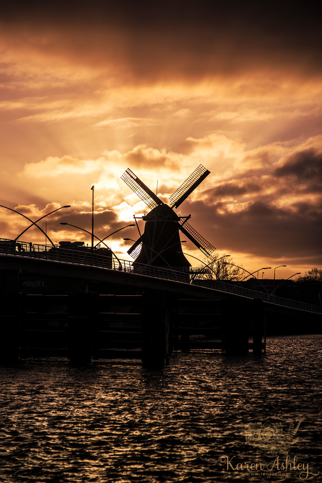 sunset Zaanse Schans windmills netherlands