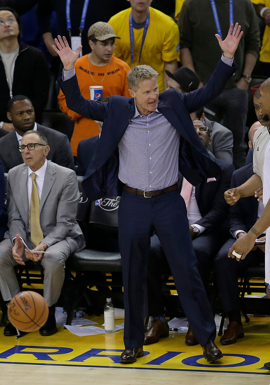. Golden State Warriors head coach Steve Kerr gestures during the second half of Game 2 of basketball\'s NBA Finals against the Cleveland Cavaliers in Oakland, Calif., Sunday, June 4, 2017. (AP Photo/Ben Margot)