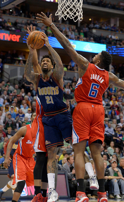 . Denver Nuggets forward Wilson Chandler (21) goes up for a shot on Los Angeles Clippers center DeAndre Jordan (6) during the first quarter. (Photo by John Leyba/The Denver Post)