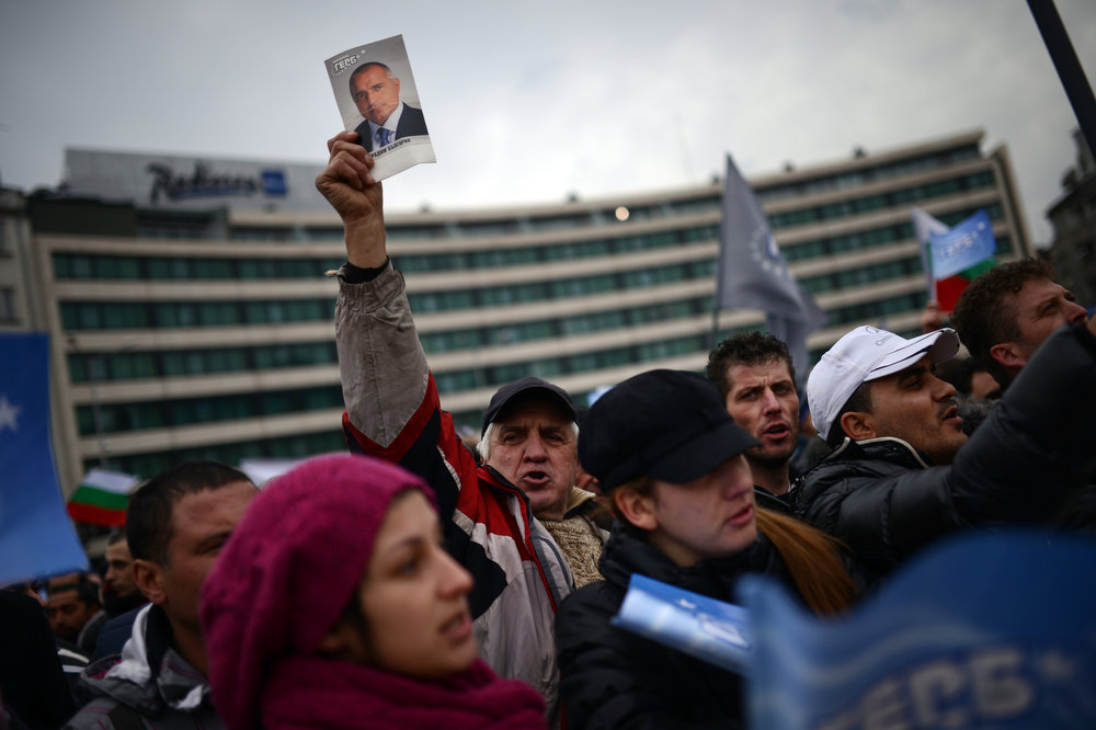 Description of . A man holds a picture of outgoing Bulgarian Prime Minister Boyko Borisov during a rally in support of him in front of the Parliament building in Sofia on February 21, 2013. Bulgaria's parliament accepted Thursday the resignation of Prime Minister Boyko Borisov's government after days of sometimes violent protests against high electricity bills and low incomes in the EU's poorest country.    DIMITAR DILKOFF/AFP/Getty Images