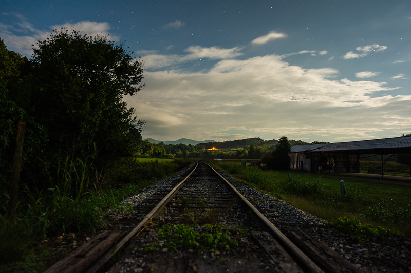 The Great Smoky Mountains Railroad tracks are lit up under the night sky seen from the Kituwah Farm in Bryson City, September 25, 2018. (Joseph Forzano / Deep Creek Films)
