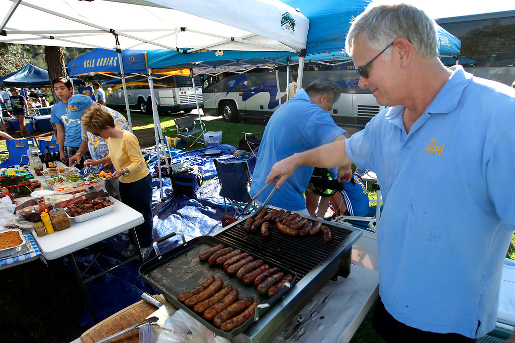 . George Browning cooks bratwurst before the UCLA-Nevada game at the Rose Bowl, Saturday, August 31, 2013. (Michael Owen Baker/L.A. Daily News)