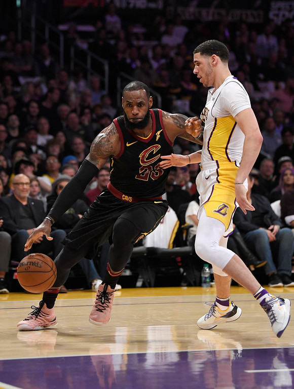 . Cleveland Cavaliers forward LeBron James, left, drives past Los Angeles Lakers guard Lonzo Ball during the first half of an NBA basketball game, Sunday, March 11, 2018, in Los Angeles. (AP Photo/Mark J. Terrill)