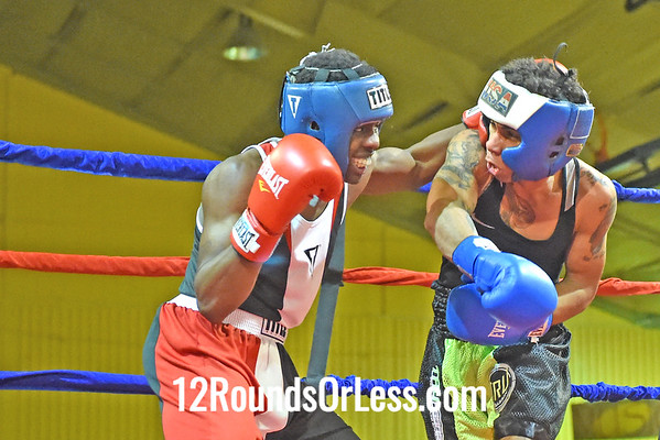 Bout 12 Armond Richard(Red Gloves), Zelma George/Empire BC -vs- Chris Lopez(Blue Gloves), Freddies BC, 132 lbs, Novice