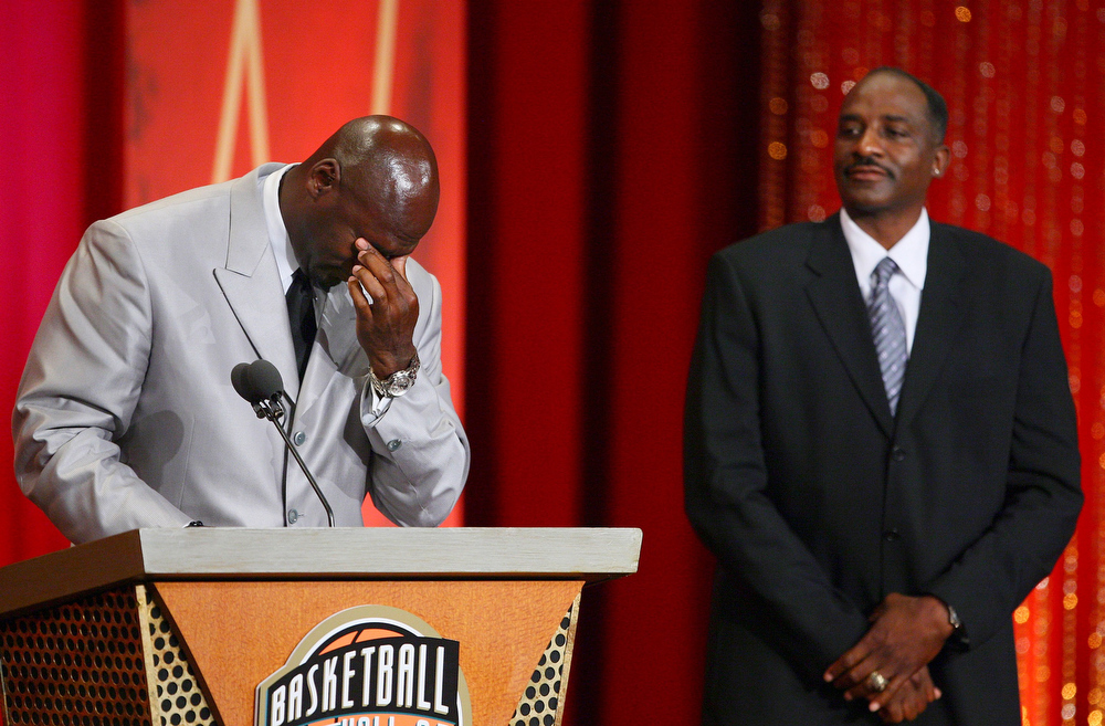 Description of . Former Chicago Bulls and Washington Wizards guard Michael Jordan wipes tears from his eyes as his presenter Hall of Fame NBA player David Thompson looks on during Jordan's enshrinement ceremony into the Naismith Basketball Hall of Fame in Springfield, Mass., Friday,  Sept. 11, 2009. (AP Photo/Stephan Savoia)