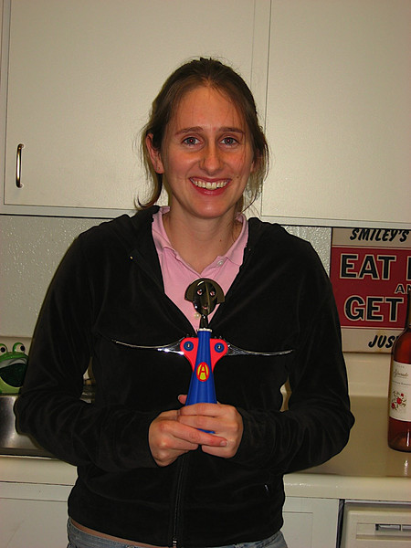 Katy with her chanukkah present, a matching wine opener!