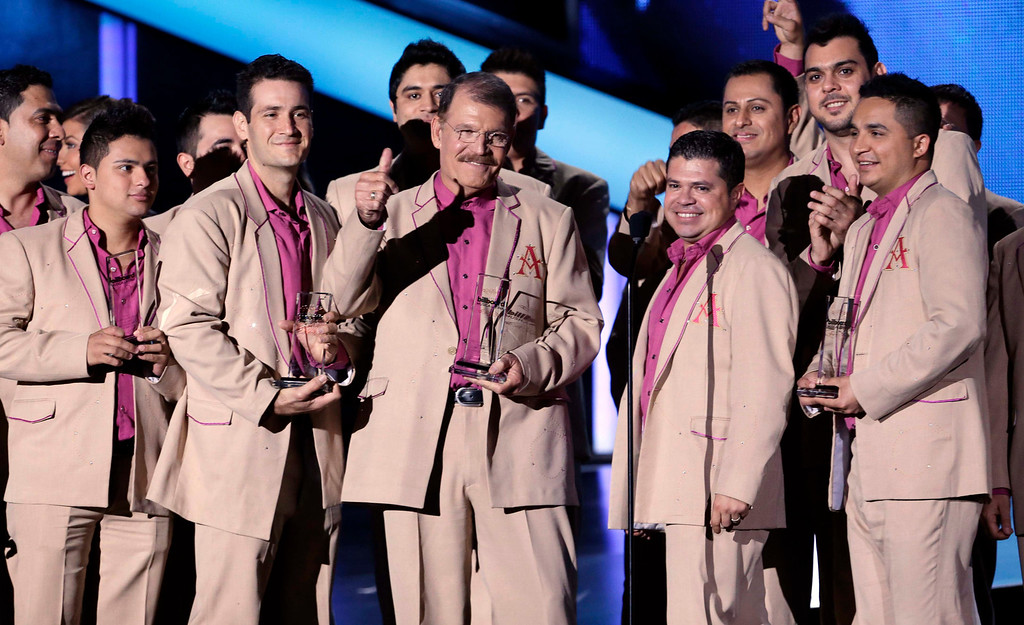 . The group La Arrolladora Banda el Limon de Rene Camacho accepts the Regional Mexican Album Artist of the Year Duo or Group award at the Latin Billboard Awards in Coral Gables, Fla., Thursday April 25, 2013. (AP Photo/Alan Diaz)