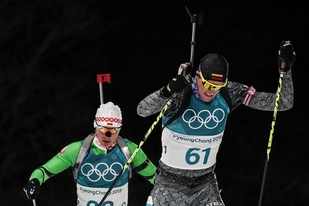 . Vytautas Strolia, of Lithuania, right, and Anton Smolski, of Belarus, compete during the men\'s 10-kilometer biathlon sprint at the 2018 Winter Olympics in Pyeongchang, South Korea, Sunday, Feb. 11, 2018. (AP Photo/Felipe Dana)