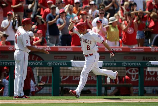 . Los Angeles Angels\' David Freese (6) celebrates his home run with third base coach Gary DiSarcina during the eighth inning of a baseball game against the Detroit Tigers, Sunday, July 27, 2014, in Anaheim, Calif. (AP Photo/Jae C. Hong)