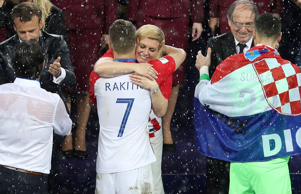 . Croatian President Kalinda Grabar-Kitarovic hugs Croatia\'s Ivan Rakitic at the end of the final match between France and Croatia at the 2018 soccer World Cup in the Luzhniki Stadium in Moscow, Russia, Sunday, July 15, 2018. (AP Photo/Thanassis Stavrakis)