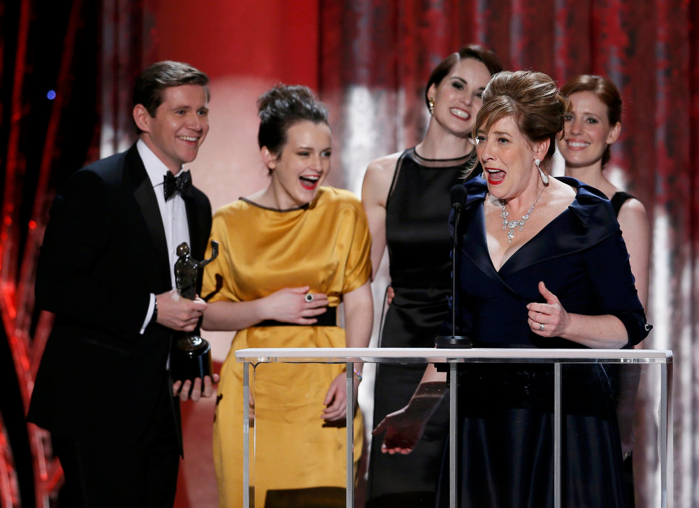 ". Actress Phyllis Logan (R, front) accepts the the award for outstanding ensemble in a drama series for ""Downtown Abbey\"" at the 19th annual Screen Actors Guild Awards in Los Angeles, California January 27, 2013.   REUTERS/Lucy Nicholson"