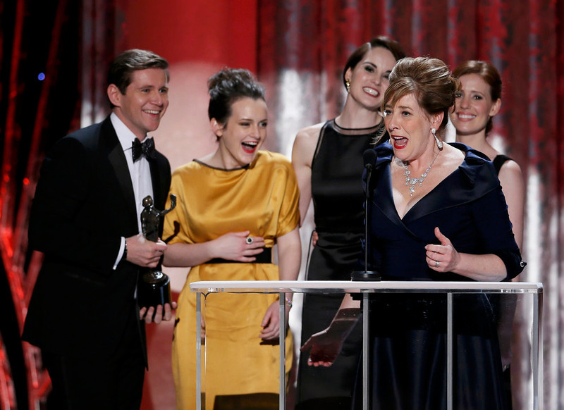 """. Actress Phyllis Logan (R, front) accepts the the award for outstanding ensemble in a drama series for \""""Downtown Abbey\"""" at the 19th annual Screen Actors Guild Awards in Los Angeles, California January 27, 2013.   REUTERS/Lucy Nicholson"""