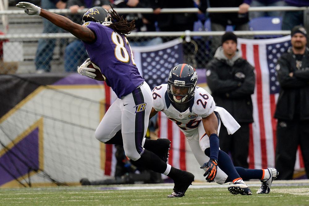 . Denver Broncos free safety Rahim Moore #26 stops Baltimore Ravens wide receiver Torrey Smith #82 at the M&T Bank Stadium, in Baltimore, MD Sunday December 16, 2012.      Joe Amon, The Denver Post