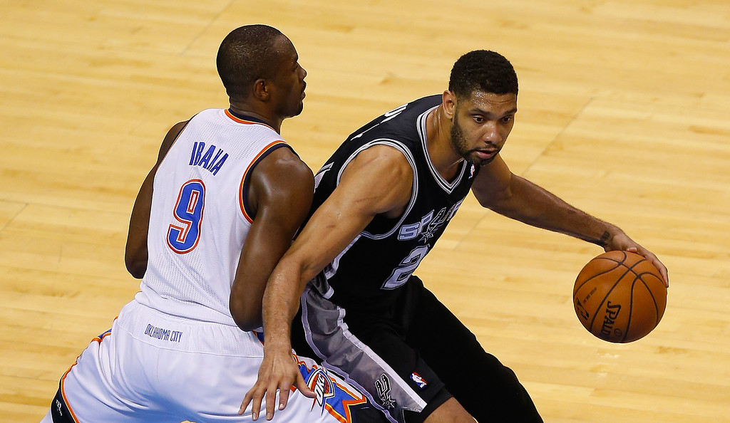 . OKLAHOMA CITY, OK - MAY 31:  Tim Duncan #21 of  of the San Antonio Spurs drves with the ball against Serge Ibaka #9 of the Oklahoma City Thunder in the second half during Game Six of the Western Conference Finals of the 2014 NBA Playoffs at Chesapeake Energy Arena on May 31, 2014 in Oklahoma City, Oklahoma. (Photo by Tom Pennington/Getty Images)