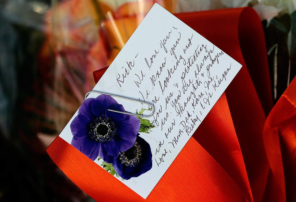 . A card is shown at the base of a cairn during a remembrance ceremony for those who died on Pan Am Flight 103 at Arlington National Cemetery December 21, 2013 in Arlington, Virginia. (Photo by Win McNamee/Getty Images)