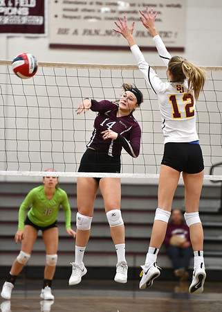 11/14/2019 Mike Orazzi | StaffrBristol Central High School's Kathryn Ross (14) at the net with St. Joseph's Ava Tuccio (12) during the Class L Second Round Girls Volleyball Tournament at BCHS.