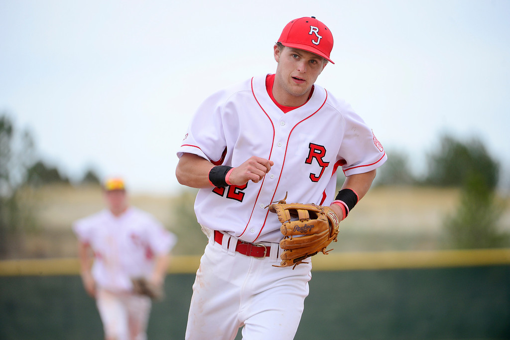 . PARKER, CO - APRIL 29: Regis Jesuit shortstop Brody Weiss runs off the field after the Raiders made three outs during the team\'s final home game. Weiss is the son of Colorado Rockies manager Walt Weiss. (Photo by AAron Ontiveroz/The Denver Post)
