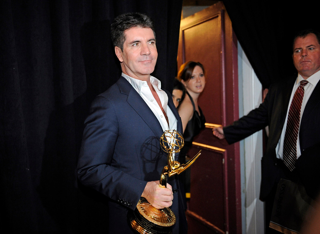 """. Simon Cowell is seen after receiving \""""The Founders Award\"""" at the 38th International Emmys Awards held on Monday, Nov. 22, 2010, in New York. (AP Photo/ Louis Lanzano)"""