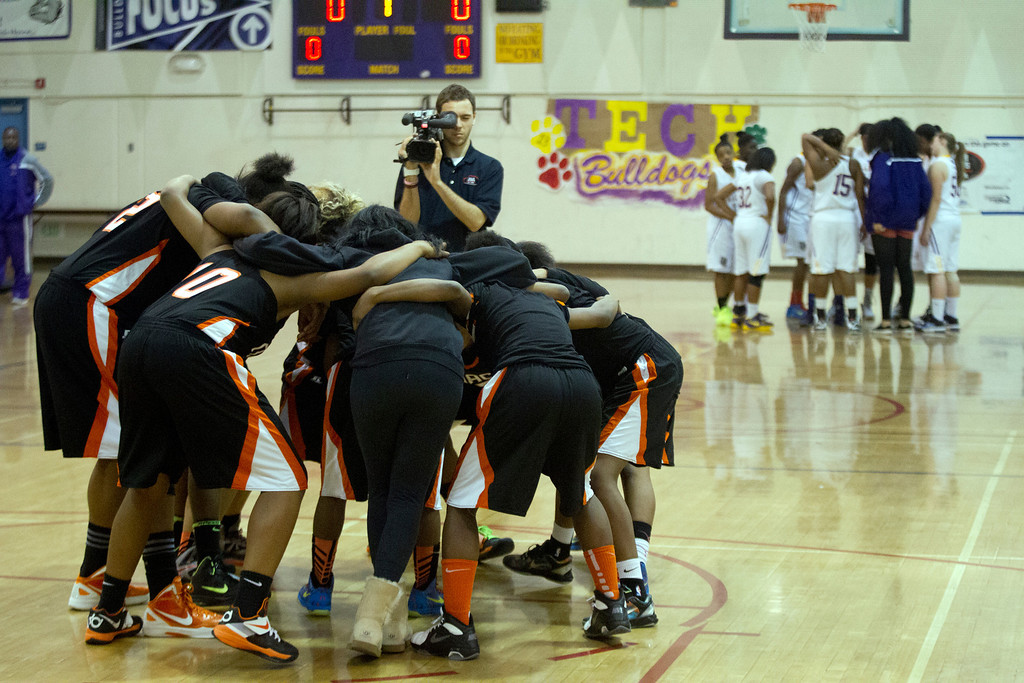 . McClymonds High School players, left, and Oakland Technical High School players get fired up before the start of their Oakland Athletic League girls\' basketball game, Wednesday, Feb. 20, 2013 in Oakland, Calif. McClymonds won, 62-50. (D. Ross Cameron/Staff)