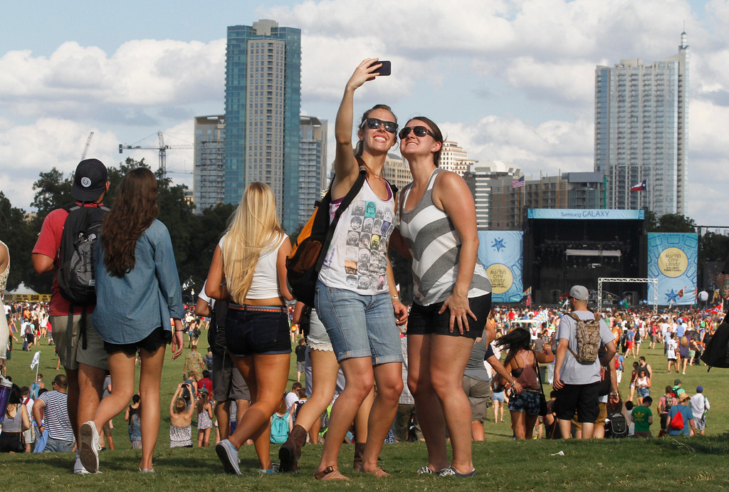 . Rikki Risinger, left, and Chelsea Moody take a self portrait on Day 1 of the 2013 Austin City Limits Music Festival at Zilker Park on Friday, Oct. 4, 2013, in Austin, Texas. (Photo by Jack Plunkett/Invision/AP)