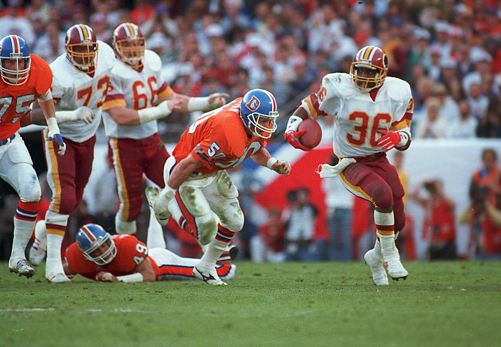 . Washington Redskins running back Timmy Smith (36) goes around Denver Broncos linebacker Jim Ryan (50) on long run in the first quarter of Super Bowl XXII in San Diego, on January 31, 1988. (AP Photo/Bob Galbraith)
