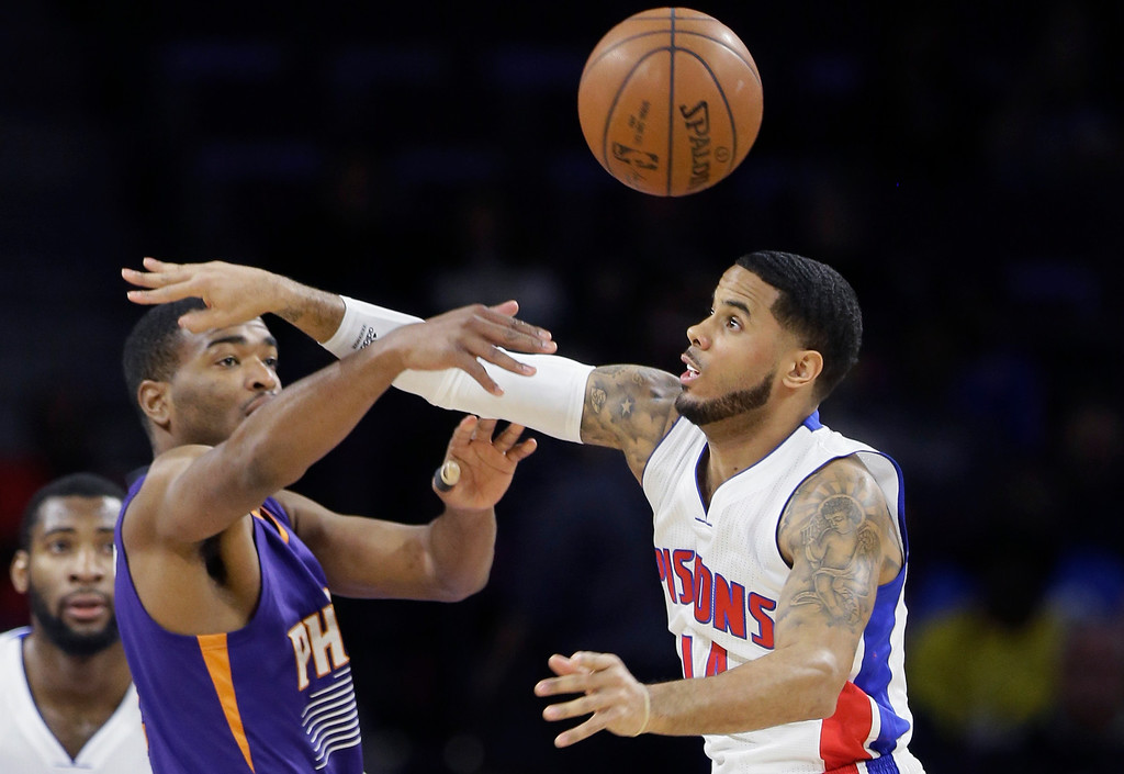 . Detroit Pistons guard D.J. Augustin, right, knocks the ball away from Phoenix Suns forward T.J. Warren during the first half of an NBA basketball game in Auburn Hills, Mich., Wednesday, Nov. 19, 2014. (AP Photo/Carlos Osorio)